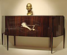 """Jacques-Emile Ruhlmann Meuble De Char cabinet, Macassar ebony and Ivory c1922  42""""x89""""x19""""    Reference to The roman era in the ivory detailing."""