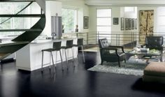 Black floor to the kitchen-dining-TV-lounge area is a must.