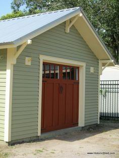 Bungalow Garage with a modern overhead door, color scheme