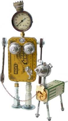 Fobot and Dogbot - 'Jojo Goes Walkies' (created 2010).  Principal Components: Candied ginger tin, pressure gauge, oil lamp part, tea balls, wrenches, hydraulic fittings, talcum tin, expansion bolts, slide buckles, pocket watch