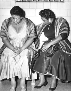 Ella Fitzgerald, left, and her assistant Georgiana Henry at an HPD station after being arrested for shooting dice. (1955)
