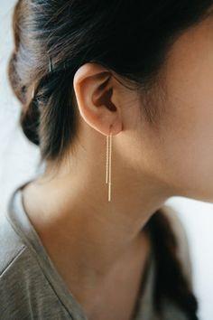 Mini needle drop gold dangle earrings.