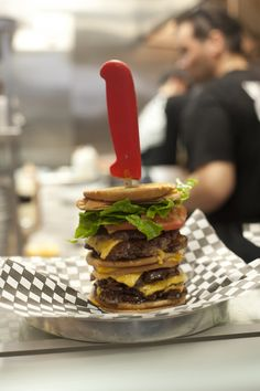 """The """"Go Chuck Yourself"""" burger at Holy Chuck in Toronto. 6 patties, triple bacon, triple cheese, and grilled cheese sandwiches instead of buns. Mouth Watering Food, Grubs, Fudge, Grilled Hamburgers, Holi, Nom Nom, Bacon, Sandwiches, Food Porn"""