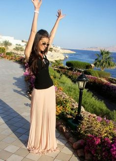 Love this outfit. Long nude colour maxi skirt and black tank top.
