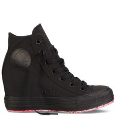 Tight Blacked-Out Converse Hi Top Wedge...  I wonder if they are comfortable?
