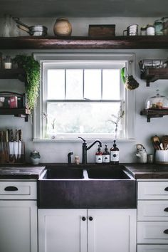 A Kitchen Remodel Fit for a Cookbook - love the dark farmhouse sink and exposed plank open shelf