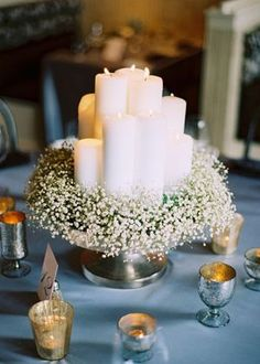 Original and budget-friendly centerpiece. Candles and baby's breath!