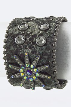 """This cuff is 100% genuine leather decorated with rhinestones and studs throughout. There is an embellishment in the middle shaped like a  10-point star decorated in crystals studs. The leather cuff has a snap button closure. Length: 6.5"""" - 7.5"""" - Width: 1.8"""" $39.99"""