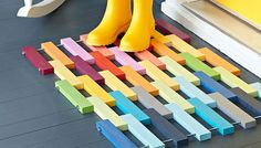 DIY Porch mat made from multi-colored wooden strips...So colorful!
