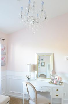 Intimate white parisian style elegant beauty room with crystal chandelier, white wainscoting, white traditional Home Design, Interior Design, Sherwin Williams White, Pink Paint Colors, Wall Colors, White Vanity, Parisian Style, Parisian Room, Parisian Apartment