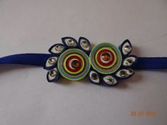 Paper quilling rakhi Quilling Earrings, Quilling Jewelry, Quilling Paper Craft, Paper Jewelry, Paper Beads, Jewelry Crafts, Quilling Rakhi, Rakhi Making, Handmade Rakhi