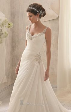 Make an impression with Blu by Mori Lee 5213. An elegant wedding gown in delicate chiffon. The pleated bodice features a v neckline with tapered straps and a v shape back. Intricate beading adorns the bodice, back and hip while the skirt extends to a train.