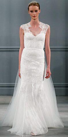 Silk white illusion neckline lace appliqué sheath with open back and detachable tulle train.