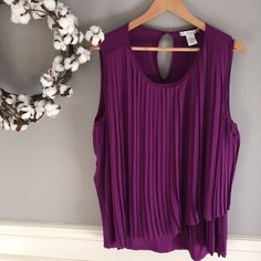 """NWT Light Plum Pleated Top Size XL NEW WITH TAGS-- You'll love this light plum top for now under a blazer or cardigan, and then in warmer weather as well! Super soft viscose, spandex blend will flow over your curves, smoothing not clinging! Gorgeous color and slightly asymmetrical hemline complete the lovely look. 29.5"""" length, 21.5"""" bust. Size XL. Design History Tops"""