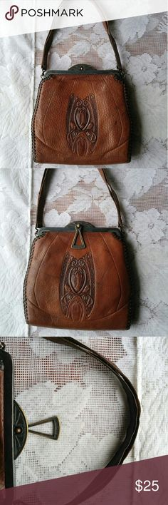 """Vintage Art Nouveau Tooled Leather Handbag BEAUTIFUL art nouveau style vintage leather purse. No brand name, but she's a beauty.  -12"""" handle -5"""" long mouth with hinge opening --5.75"""" long clasp to bottom I don't have a way of identifying the age of this purse, but it's old. Lining is a little crumbly, the corner of one inner pocket is loose, and the double layers of the handle have separated. Leather of body is in great vintage shape with light wear. Bags Mini Bags"""