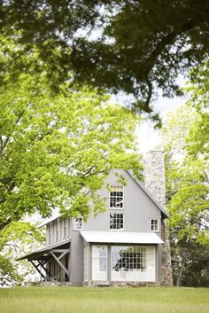 BECKI OWENS--Colors of the Modern Farmhouse + Paint Guide. Beautiful Gray/Greige Farmhouse exterior.