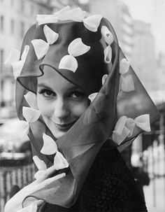 A spring-themed hat by Simone Mirman modelled by Sandra Paul - later Sandra Howard, the wife of the Conservative MP Michael Howard.