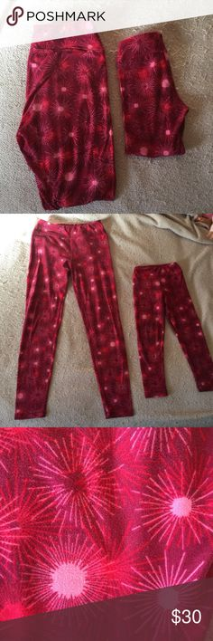 Cute Lularoe Mommy and Me Set OS and S/M Leggings Pretty berry/pink/red leggings set. The   Adult leggings are size OS, and only worn and washed once. The child's leggings are S/M - which is the smallest size Lularoe makes. Fits my 4 year old perfectly. The child leggings have been worn a few more times, and show a little pilling at knees/backside. See photo. The photo is very close-up. I would consider them in good used condition. Made in China LuLaRoe Other