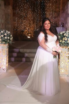 Stunning plus size bride with off shoulder sleeves and flowy chiffon skirt. Studio Levana