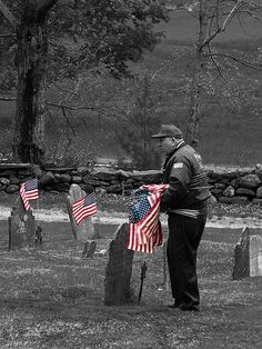 Old Glory Never Fades.   Jim honors each soldier with a little flag.