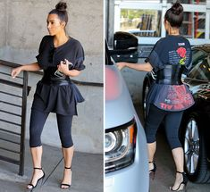 Not sure what slays more -- Kim's corset or our pix of Kim in her corset belt! The eyelashes! The corset! The up-do! The capri leggings! Slay, bitch!