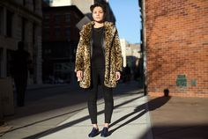 Advanced layering: leather jacket under leopard coat