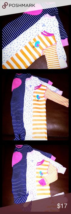 """Carter's"" 3 Pair Footie PJ's•EXCELLENT CONDITION ""Carter's"" 3 Pair Footie PJ's • One is Navy Blue & White Striped w/ a big Pink Heart in the center • Another is White w/ a Blue Cherry pattern & then a light Pink embroidered Cherry 🍒 on the top left w/ a light Pink border at the neck & wrists • The last one is Orange & White striped w/ a Turquoise & Pink birdie next to a Yellow, Pink & Green Flower - there's also a Pink border around the neck & wrists. ALL ARE IN EXCELLENT CONDITION!🍒🌿🌺…"