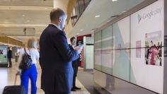 Google's Futuristic Airport Billboards Are Interactive, Allow You To Download Content