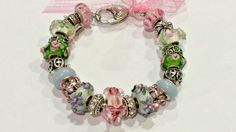 This Pandora compatible Murano glass bead bracelet has 21 beads consisting of 9…