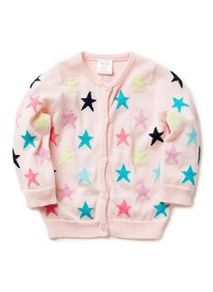 100% Cotton Cardigan. Fully-fashioned knit cardigan in super-soft cotton. Crew neck with 1x1 rib finishes on neckline, cuffs, front opening and hem. Button-through front with all over multi-coloured, intarsia star. Regular fitting silhouette, available in Cotton Candy.