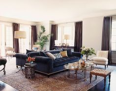 """persian rug + navy couch"""" library"""