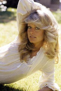 Farrah Fawcett--an actress that started a hairstyle. Everyone wanted Farrah Fawcettt hair!!