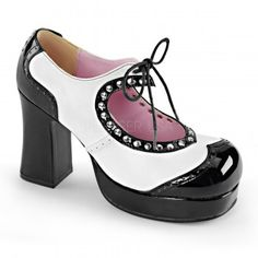 Black and White Heart Cut Out Mary Jane Pump - New at GothicPlus.com Price: $61.95  They have a 3 3/4 inch heel and 3/4 inch platform with tie closure on the Mary Jane strap above the studded heart shaped cut out.  All man made materials with a padded insole and non-slid sole.  #gothic #fashion #steampunk