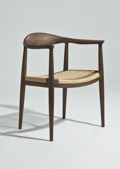 The Larsen Arm Chair with Cord Seat has a solid wood frame and a woven…