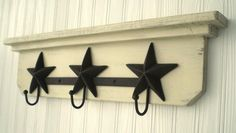 Ready to Ship-Primitive Wooden Wall Hanger / Shelf with Rusty Star Hooks Shabby Chic / French Country-Butterscotch. $55.00, via Etsy.
