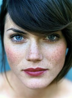 Gorgeous freckles, rosy blush, plum lips