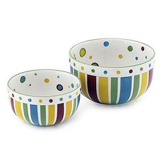 "SIMPLY SUMMER SERVING BOWLS - SET OF 2  Food just seems to taste better when served from these hand painted stoneware bowls festooned with sassy stripes and perky polka dots. Fired at a high temperature to increase durability. Oven, microwave and dishwasher safe. 7¼ x 4"", 9¼ x 5""  Set of 2.  Item: 93281  $44.00  www.celebratinghomewithjulia.com"