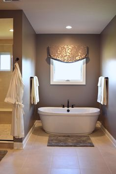A master bathroom feels so serene with this beautiful off white ceramic tile. | Home Inspiration | Master Bathroom | Ceramic Tile | Neutral Colors | Home Renovation |