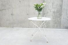 We have two of these very pretty and practical garden tables. In excellent condition and ready to use as they are with an umbrella hole in the middle. Shop our full collection of Tables here at Vinterior Vintage Chairs, Vintage Table, Vintage Furniture, Metal Garden Table, Garden Chairs, Table Furniture, Furniture Design, Outdoor Tables, Hanging Chair