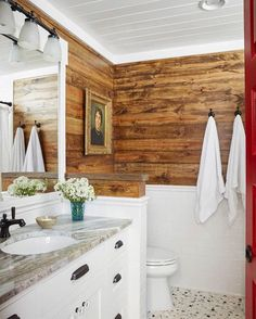 This bathroom from #HGTVMagazine features stained shiplap walls and a painted ceiling. Click the #linkinbio to see the rest of the home!