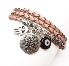 ** I really like Lori's designs and she sells on etsy, too! ** Pink Braided Leather Wrap Bracelet with Protection Charms $36.00 #jewelry #handmade #bracelet