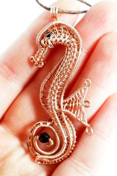 https://www.etsy.com/listing/163608816/wire-wrapped-beaded-seahorse-pendant?ref=unav_listing-same