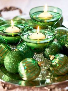 Nice Christmas Decor -- Green Ornaments and Candles in Green Dishes (or green tinted liquid) on a Reflective Tray or Mirror.