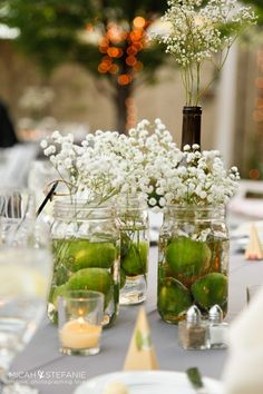 Mason jars filled with limes + baby breath I #bridalshower I everybody loves flowers