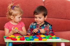 Preschooler social Developement by them playing and sharing the blocks with each other