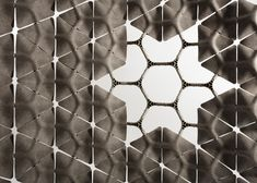 Layer uses large hemp tiles to create Scale partition system