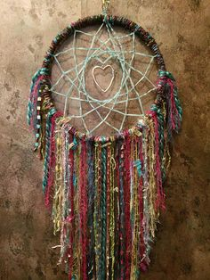 Dreamcatcher Gift~Bedroom Dreamcatcher~Bohemian Gypsy Dreamcatcher~Boho Style Dreamcatcher~Boho Gypsy Dreamcatcher~Bedroom Dreamcatcher Gift~The 9.5 inch Hoop is wrapped with a Soft Hunter Green Yarn with Teal, Pink & Green Ribbon throughout~The Handwoven Web is a Lite Blue