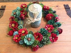 Christmas is just around the corner. These hand painted pinecones in shades of red and green will put you right in the holiday spirit. Pine cones are wired to frame and can be used outside but preferably under a covered porch. 13.5 x 13.5 in diameter.