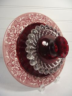 Vintage plates and glassware have been re-cultivated into fantastic garden art flowers or home wall décor for all to enjoy year round. This