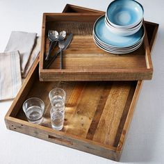 Made from repurposed pine shipping pallets, these Reclaimed Wood Trays have extra-wide surfaces that make them easy to move. Use them to keep a coffee table organized or serve drinks.